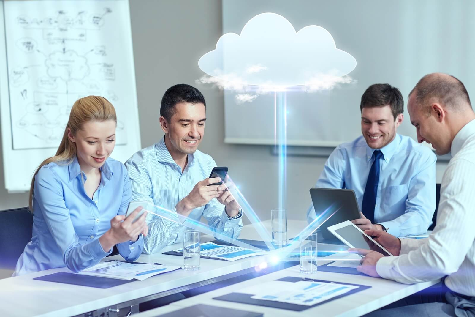 smiling team in conference room using cloud technology