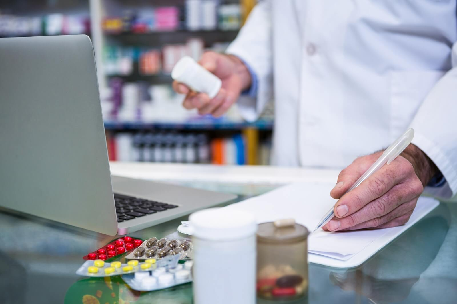 Pharmacist writing perscription