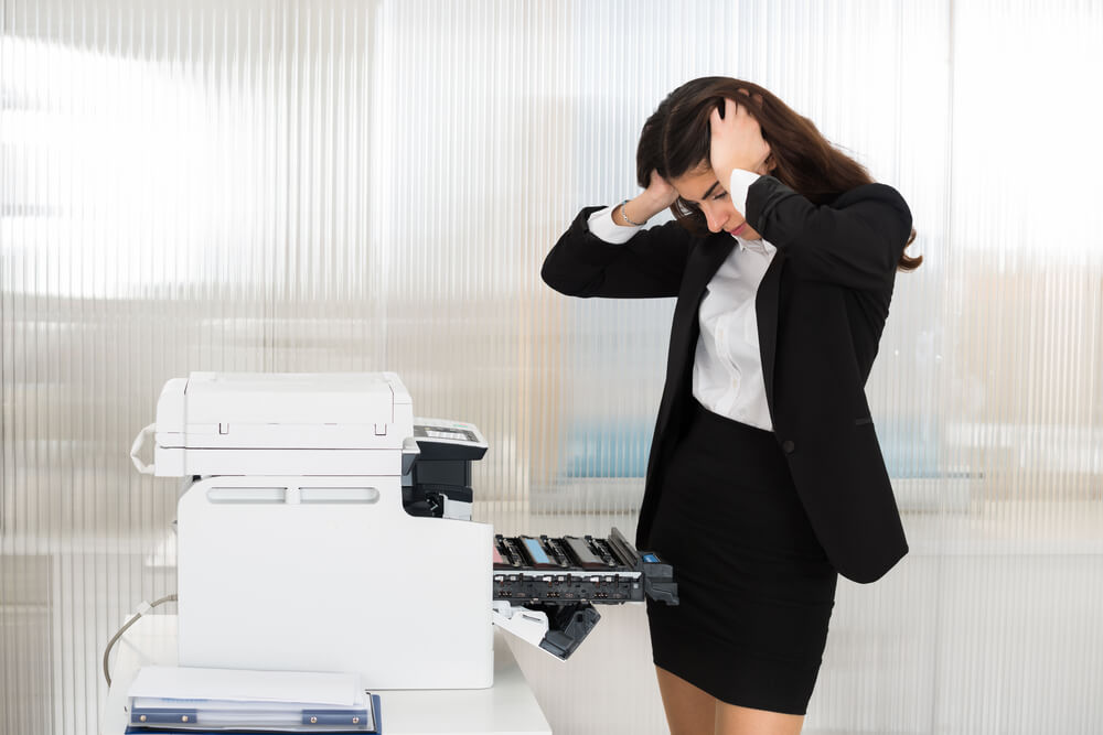 Worker frustrated by fax machine